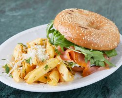 Bagel with cream cheese, smoked salmon, rocket salad & french fries image
