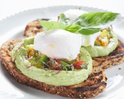 Toast with avocado, poached eggs and bell peppers salsa image