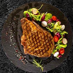 Rib Eye bone in steak image