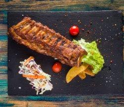 Coaste de porc cu cartofi cu rozmarin si salata coleslow image