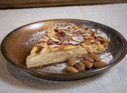 Apple & almonds tart slice image