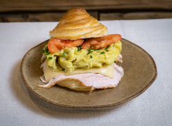 Scrambled eggs croissant image