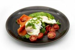 Poached eggs with avocado and smoked salmon image