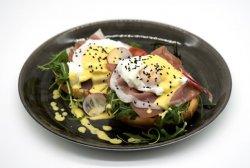 Prosciutto crostini and arugula eggs benedict image