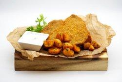 Crispy beef schnitzel with batata harra image