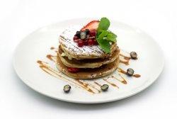 Strawberry mascarpone pancakes with salted caramel sauce image