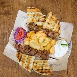 Ofertă meniu souvlaki porc + Suc Gratuit image