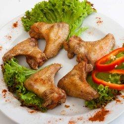 Aripioare crocante cu mujdei/ Chicken wings with garlic image