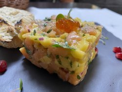 Salmon tartar with avocado dressing image