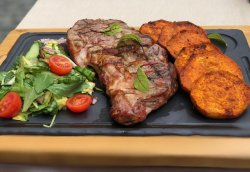 Boston steak with fresh salad and sweet potatoes fries image