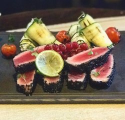 Tuna file in black sesame crust with zuchinni goat cheese rolls image