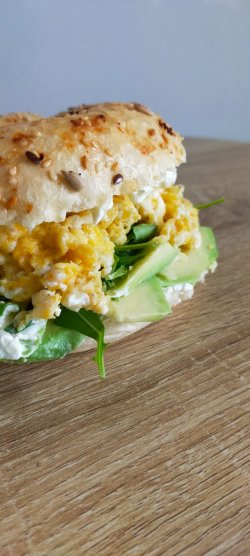 Avocado and scrambled egg bagel image