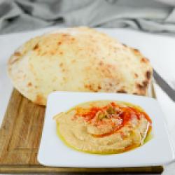 Hummus Home made & sea flakes pita image