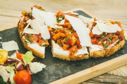 Bruschetta tomatoes and parmesan cheese