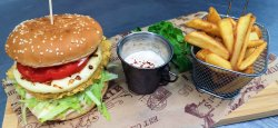 Kentucky chicken burger with Halloumi cheese and Wedges fries image