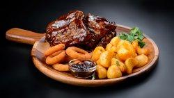 Texas BBQ Ribs, garlic patatoes, fried onion rings, chilli jam image