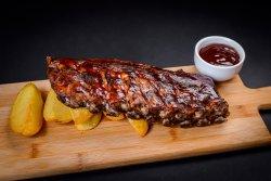 Coaste de porc slow cooking cu carftofi wedges și sos bbq image