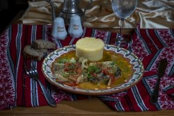 Saramură de crap cu mămăliguță/Carp brine with polenta image