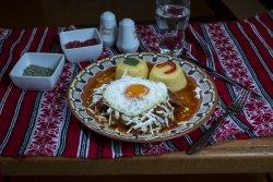 Tochitură țărănească cu mămăliguță, ou, brânză telemea, smântână/Peasant tochitura with polenta, egg, salted cow cheese, sour cream image