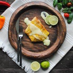 File de șalău la cuptor cu sos lemon butter și orez cu legume image