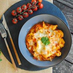 Tortellini con prosciutto al forno image