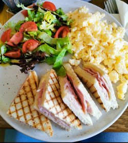 Scrambled eggs with ham & cheese toast image
