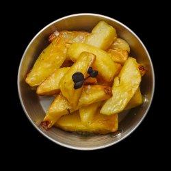 Cartofi copți în untură de rață image