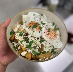 Cheesy potatoes with sunny side up eggs image