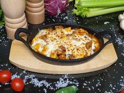 Tortellini al forno con cotto di parma, mozzarella e funghi
