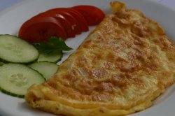 Omletă cu șuncă și cașcaval/Omlette with ham and cheese image